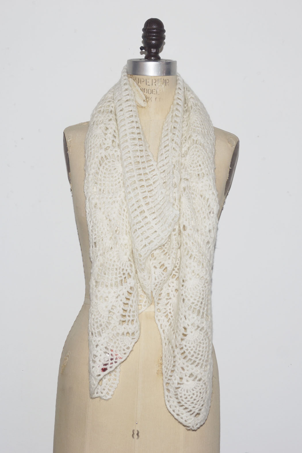 white scarf with button